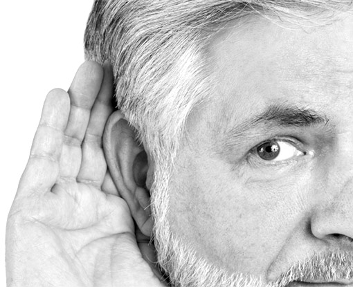 hearing loss in man with hand to ear, trying to hear