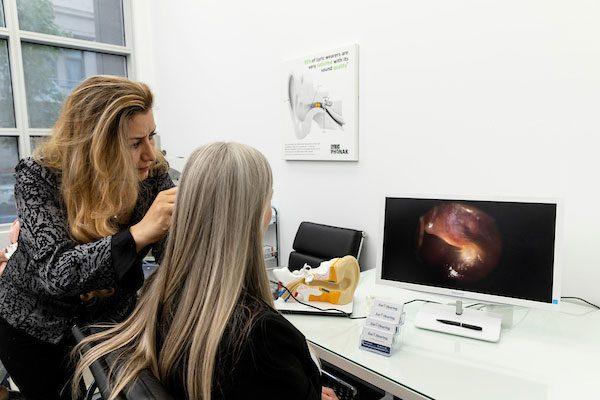 Audiologist inspeciting inner ear