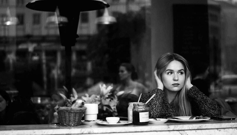Woman cannot hear well and feeling lonely at cafe